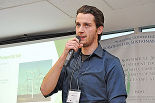 Graduate student immersed in research on community sustainability